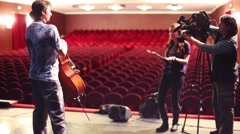 Violinist are interviewed after Taper show in Palace on Yauza Stock Footage