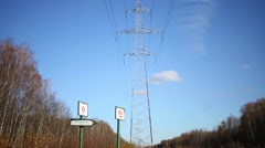 Power lines with long wires at background of blue sky Stock Footage