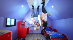Father, mother and children on ceiling at inverted house Stock Footage