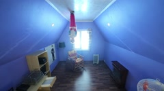Little girl stands on ceiling upside down at inverted house Stock Footage
