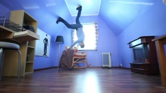 Man on ceiling upside down in blue room in inverted house Stock Footage