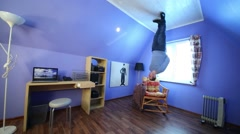 Man in jeans stands upside down in inverted house at sunny day Stock Footage