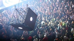 Many people dance during modern laser show with big cube Stock Footage