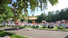 People sunbathe near pool the Bassein In Sokolniki. Stock Footage