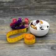 Centimeter and granola with yogurt - stock photo