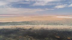 View to the sky and the salt lake in Atacama desert, Chile. Stock Footage