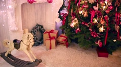 Room with decorative fireplace decorated to christmas celebration Stock Footage