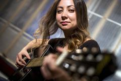 Guitar playing girl. Stock Photos