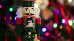 Toy Nutcracker, fir branches with illumination of Christmas tree Stock Footage