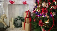 Christmas tree with gift boxes and decorative fireplace Stock Footage
