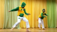 Capoeira fight. Kids dancing in capoeira performance on stage Stock Footage