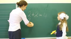 Girl and teacher stand and solve simple math examples Stock Footage