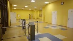 Modern new hall with door and turnstiles and corridor in school Stock Footage