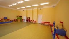 Play room with childish furniture and toys in new kindergarten Stock Footage