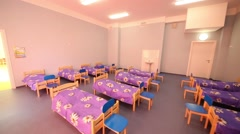 Big empty clean room with small wooden beds and playroom Stock Footage