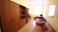 Empty room with sofa, bookcases, chairs for teachers in school Stock Footage