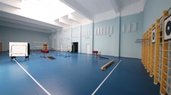 New school gymnasium with blue floor and exercise equipment Stock Footage