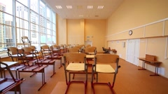 New school classroom with chairs on desks with bid windows Stock Footage