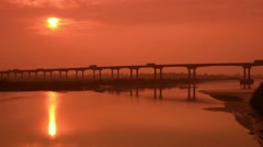 Time lapse traffic at sunrise on m62 crossing river ouse howden united kingdom Stock Footage