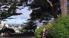 San Francisco, Telegraph Hill and woman walking Stock Footage