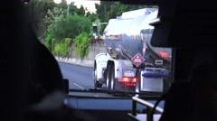 Fuel delivery truck on freeway Stock Footage