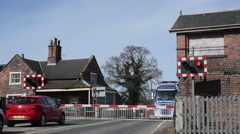 Lorry driver waiting at railway level crossing at Howden station united kingdom Stock Footage