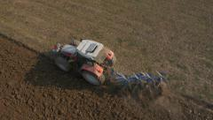 Aerial - Tractor plowing a field burying any crop residue in the process - stock footage