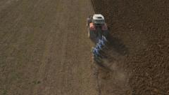 Aerial - Agricultural preparation of soil by mechanized work Stock Footage