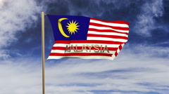 Malaysia flag with title waving in the wind. Looping sun rises style.  Animation Stock Footage