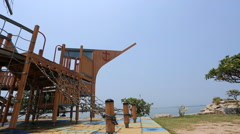 Pirate ship playground structure in the park Stock Footage