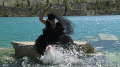 Woman In Black Splashing Water  on the  Pond Stock Footage