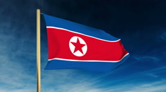 North Korea flag slider style. Waving in the wind with cloud background Stock Footage