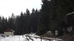 4k Snowing small station in winter mountain forest Harz Stock Footage