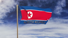 North Korea flag with title waving in the wind. Looping sun rises style Stock Footage