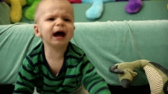 Baby boy is crying on the floor FULL HD tracking shot CLOSE - stock footage