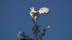 Weathervane weather vane nesw cockerel rust deep blue sky Stock Footage