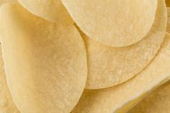 Prepared potato chips snack closeup view - stock photo
