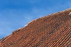 Broken terracotta tile on a roof Stock Photos