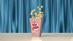 A classic popcorn box is filled with yummy popcorn Stock Footage