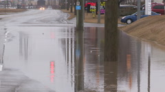 Local city street and ditches flooded after heavy rain storm Stock Footage