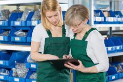 Women working in storehouse Kuvituskuvat