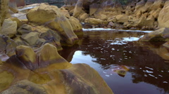 Yellow and red rocks water Stock Footage