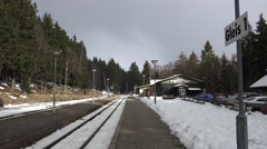 4k Small station snowy winter sunny mountain forest Harz Stock Footage