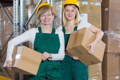 Female storage workers Kuvituskuvat