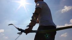 Man using bow and arrow, archery - stock footage