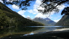 New Zealand Lake Gunn tranquil reflective water and distant peaksk Stock Footage