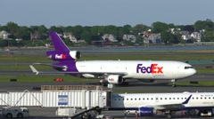 FedEx freight jet plane arrival, taxies to cargo terminal - stock footage