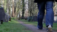 Man walks down Beautiful Church Yard Path Picturesque Scene in Morning Light - stock footage