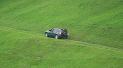 Car going backwards on dangerous mountain road Stock Footage