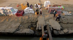 Timelapse of laborers loading a boat on the Irrawaddy,Irrawaddy,Burma - stock footage